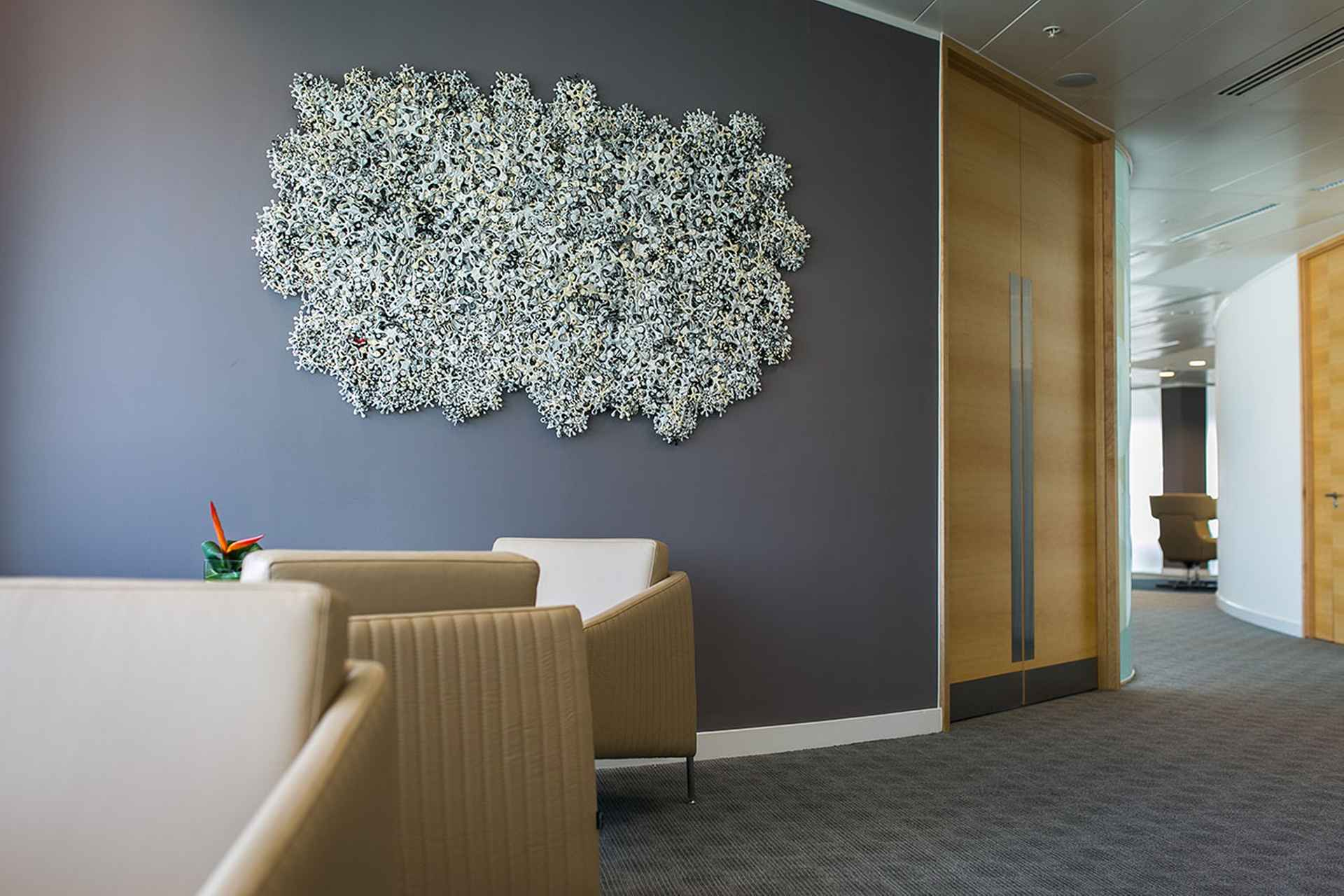Tactile, specially commissioned, wall mounted sculpture by Stephen Farley by TLT Solicitors